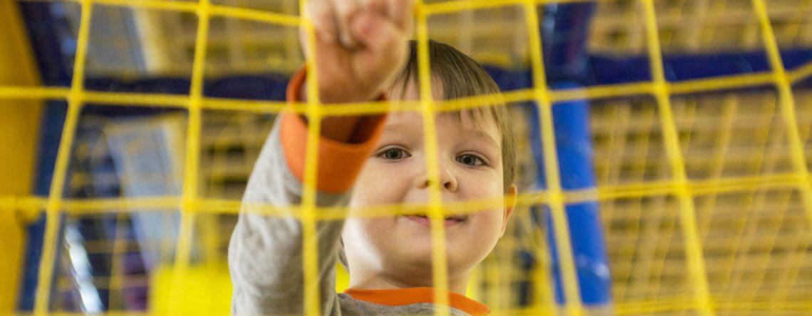 child in softplay net