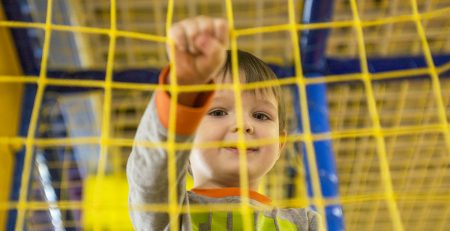 child in softplay net